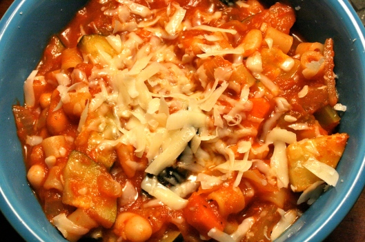 Minestrone soup with mirepoix, zucchini, cannellini beans, ditalini pasta, crushed tomatoes and parm.